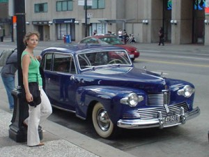 Me standing by a blue car