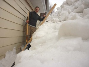 At least 5 feet of snow piled up against the garage.